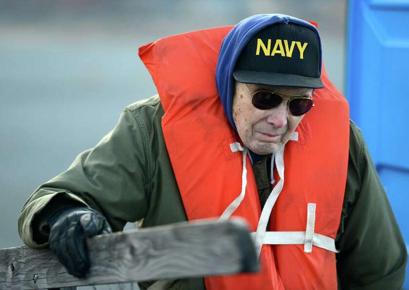 Tom McLaughlin, 79, watches as the USS Slater is moved from the Albany, N.Y., side of the Hudson Riv