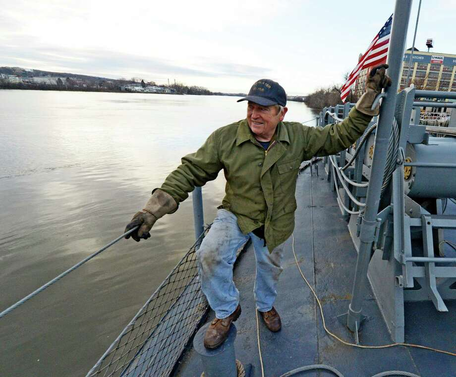 Volunteer Gene Jackey mans the lines as the USS Slater is moved from the Albany, N.Y., side of the Hudson River to the Rensselaer side on Dec. 19, 2012.     (Skip Dickstein/Times Union) Photo: Skip Dickstein / 00020379A