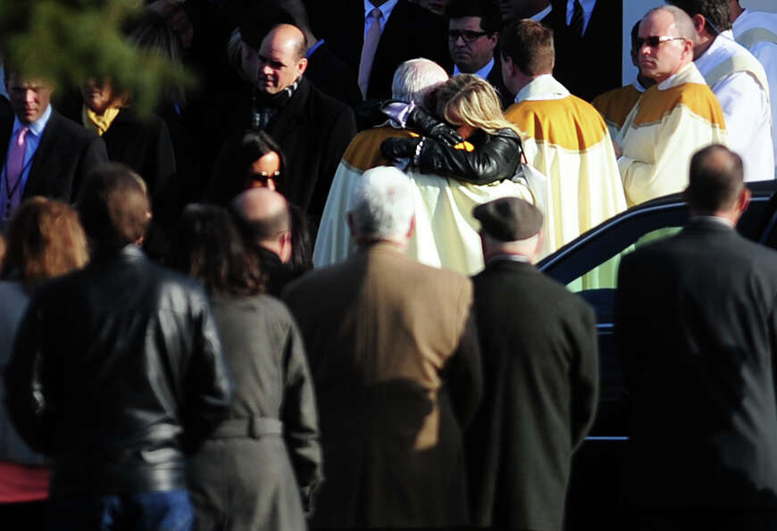 Mourners leave St. Rose of Lima Roman Catholic Church in Newtown, Conn. Wednesday, Dec. 19, 2012 fol