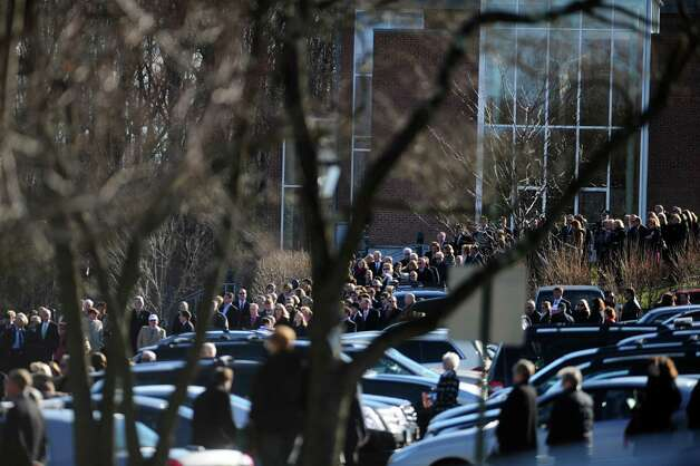Mourners fill the parking lot at St. Rose of Lima Roman Catholic Church in Newtown, Conn. Wednesday, Dec. 19, 2012 as they wait the enter the church for the funeral of Caroline Previdi, a student victim of the Newtown shootings. Photo: Autumn Driscoll / Connecticut Post