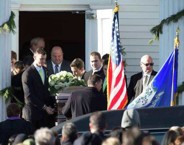 Mike Ross Connecticut Post freelance -A casket carrying the body of teacher Victoria Soto, 27, leaves  Lordship Community Church on Dec. 19, in Stratford, Conn. Photo: Mike Ross / @www.mikerossphoto.com