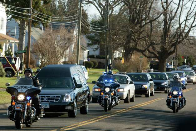 Mike Ross Connecticut Post freelance - Funeral procession carrying the body of teacher Victoria Soto, 27, makes their way down Prospect Drive in Stratford, CT on way to funeral proceedings at Lordship Community Church on Dec. 19, 2012. Photo: Mike Ross / @www.mikerossphoto.com