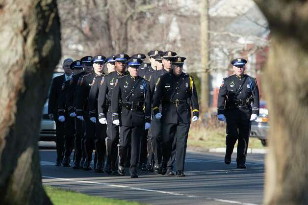 Mike Ross Connecticut Post freelance -A police honor guard arrives for funeral services for teacher Victoria Soto, 27, at the Lordship Community Church on Dec. 19, in Stratford, Conn. The first grade teacher reportedly died while trying to protect her students during last Friday's shooting massacre at Sandy Hook Elementary School in Newtown. Photo: Mike Ross / @www.mikerossphoto.com