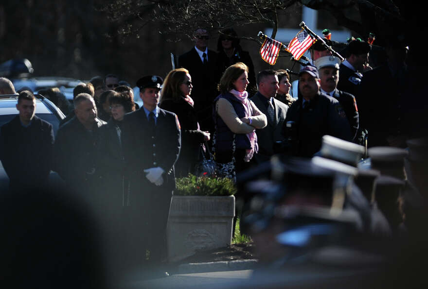 Mourners fill the parking lot at St. Rose of Lima Roman Catholic Church in Newtown, Conn. Wednesday,