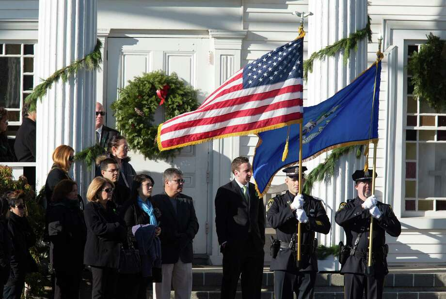 Mike Ross Connecticut Post freelance -A police honor guard waits with family and friends for the funeral services for teacher Victoria Soto, 27, at the Lordship Community Church on Dec. 19, in Stratford, Conn. The first grade teacher reportedly died while trying to protect her students during last Friday's shooting massacre at Sandy Hook Elementary School in Newtown. Photo: Mike Ross / @www.mikerossphoto.com