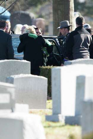 Mike Ross Connecticut Post freelance -Family and Friends embrace while attending the burial for Victoria Soto, at Union Cemetery  on December 19, 2012 in Stratford, Connecticut. Photo: Mike Ross / @www.mikerossphoto.com