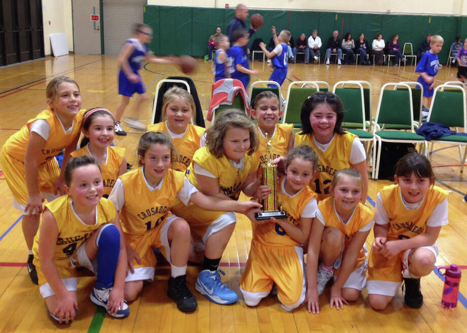The St. Mary's of Waterford Pee Wee Girls Basketball team captured the championship title in the Troy CYO Tournament Nov. 16-17. Pictured are, back row, from left: Cecelia Boisvert, Maddie Finn, Mille Carson, Caroline Field, and Megan Gendron. Front row: Brenna Graber, Molly Sweeter, Lauren LaForest, Emily Delisle, Amberly Len, and Abbey Cowieson.  Sarah Boucher also plays on the team. Coaches are  Shannon Gendron and Steve Delisle.