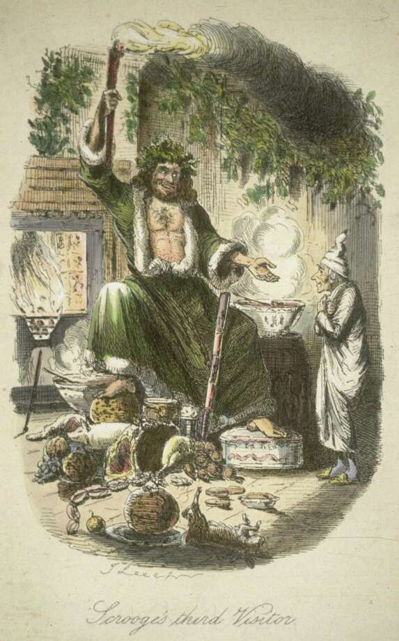 """The Ghost of Christmas Present appears to the miserly Scrooge in this 1900 era print. The 1938 and 1984 versions of """"A Christmas Carol"""" will air on TV. """"A Christmas Carol"""" (1938) airs 12/24 at 3 a.m.on AMC. The 1984 version airs on AMC on 12/24 at 3:30 p.m. Photo: Hulton Archive, File Photos / Hulton Archive"""