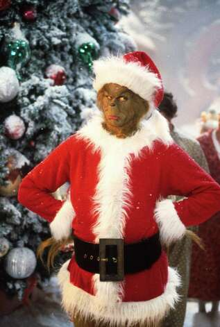 "Jim Carrey stars as The Grinch. The 2000 movie ""Dr. Seuss' How the Grinch Stole Christmas"" airs 12/25 at 7:30 p.m. on ABC. Photo: Getty Images, File Photos / Getty Images North America"