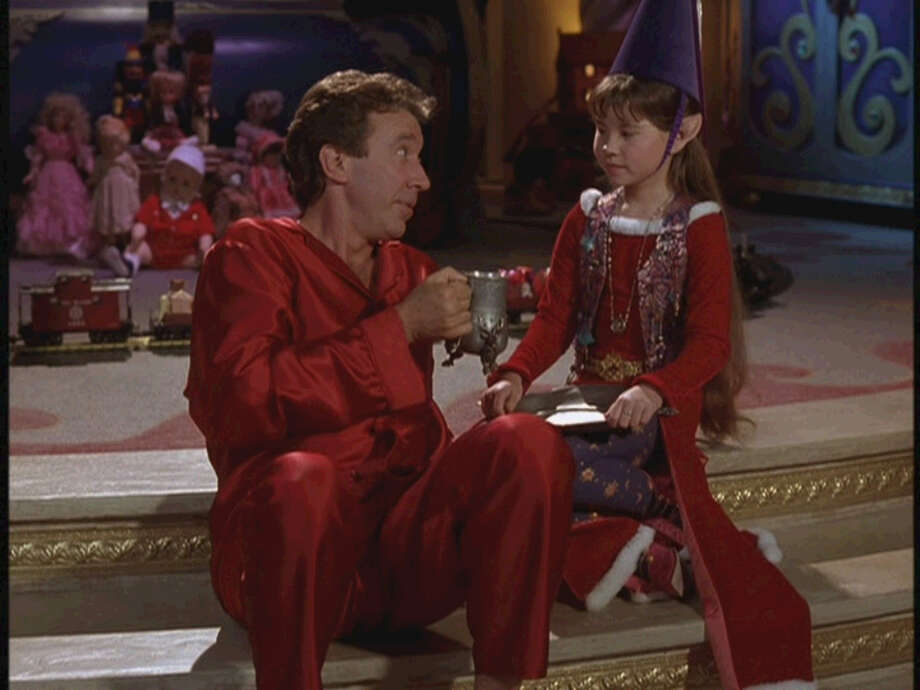 """Tim Allen as Santa Claus at the North Pole enjoys a cup of cocoa in """"The Santa Clause."""" ABC Family airs this 1994 movie:  Fri 12/21 at 8:00 pm, Sat 12/22 at 5:00 pm,  Mon 12/24 at 2:00 pm, Tue 12/25 at 10:00 am. Photo: Courtesy, File Photos"""