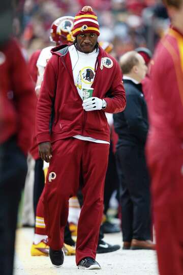 Washington Redskins quarterback Robert Griffin III on the sideline against the Cleveland Browns duri