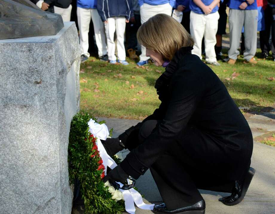 First Selectman Jayme Stevenson lays a wreath at Spring Grove Cemetery in Darien Saturday, Dec. 15,  in remembrance of the students and adults killed in yesterday's tragic shooting in Newtown. Photo by Jeanna Petersen Shepard Photo: Contributed Photo