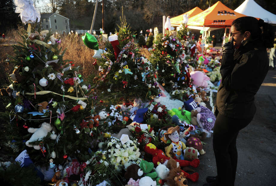 The victims memorial by the entrance to Sandy Hook Elementary School on continues to swell in size as mourners drop off remembrances on Wednesday, December 19, 2012. Photo: Brian A. Pounds / Connecticut Post