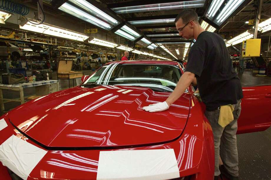 A worker checks the paint on a Camaro at a GM factory. The government bailed out GM in 2008 and 2009. Photo: Frank Gunn, SUB / The Canadian Press
