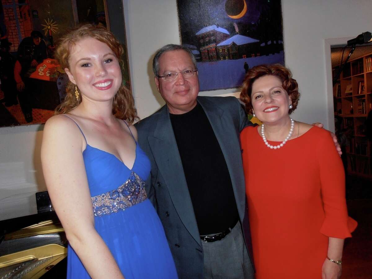 After a home concert benefiting Musical Bridges Around the World, Canadian mezzo-soprano Carolyn Sproule, from left, and French concert pianist Hugues Leclre visit with host and Musical Bridges Artistic Director Anya Grokhovski-Michaelson.