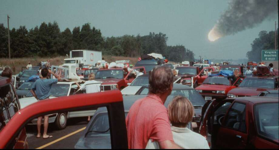 "No, by the end of the year we are not going to see something play out like this scene from the movie ""Deep Impact."" The world is not ending Dec. 21, there will be no planetary alignment causing a worldwide blackout Dec. 23, and you don't have to keep your eyes peeled for some planet named Nibiru hurtling toward Earth. Schools play a role in helping students sift through the misrepresentations of the web. (AP Photo/Paramount Pictures/DreamWorks Pictures) / PARAMOUNT DREAMWORKS PICTURES"