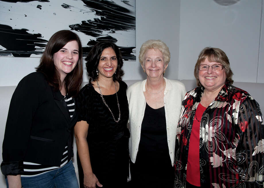 OTS/HEIDBRINK.  Association for Women in Communications social media chair Becky Stinemetze, outgoing president Salwa C. Lanford, historian Barbara Dean Hendricks and incoming president Ginger Hall Carnes get together for a holiday party and changing of the guard at Feast. Photo by Jamie Karutz. Photo: Jamie Karutz / Special to the Express-News