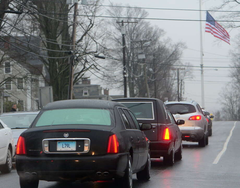 A funeral procession follows the hearse carrying the casket of Sandy Hook Elementary School shooting victim, Jack Pinto, 6, Monday, Dec. 17, 2012, in Newtown, Conn. (AP Photo/David Goldman)