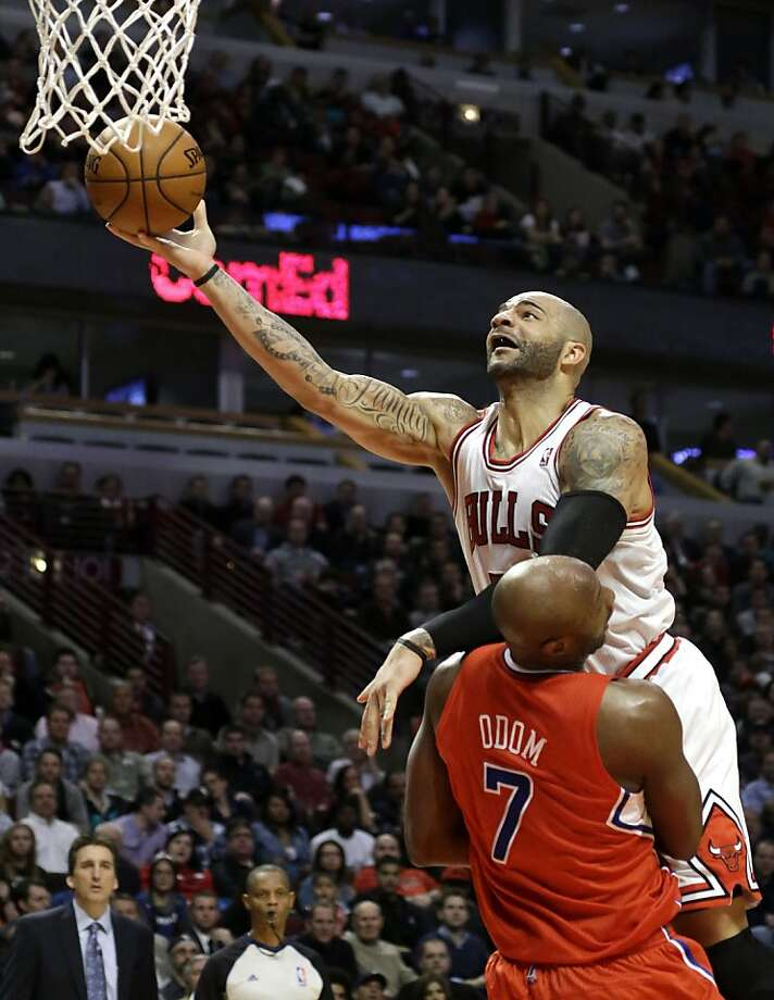 Los Angeles Clippers forward Lamar Odom (7) draws a charging foul from Chicago Bulls forward Carlos Boozer during the second half of an NBA basketball game Tuesday, Dec. 11, 2012, in Chicago. The Clippers won 94-89. (AP Photo/Charles Rex Arbogast) Photo: Charles Rex Arbogast, Associated Press