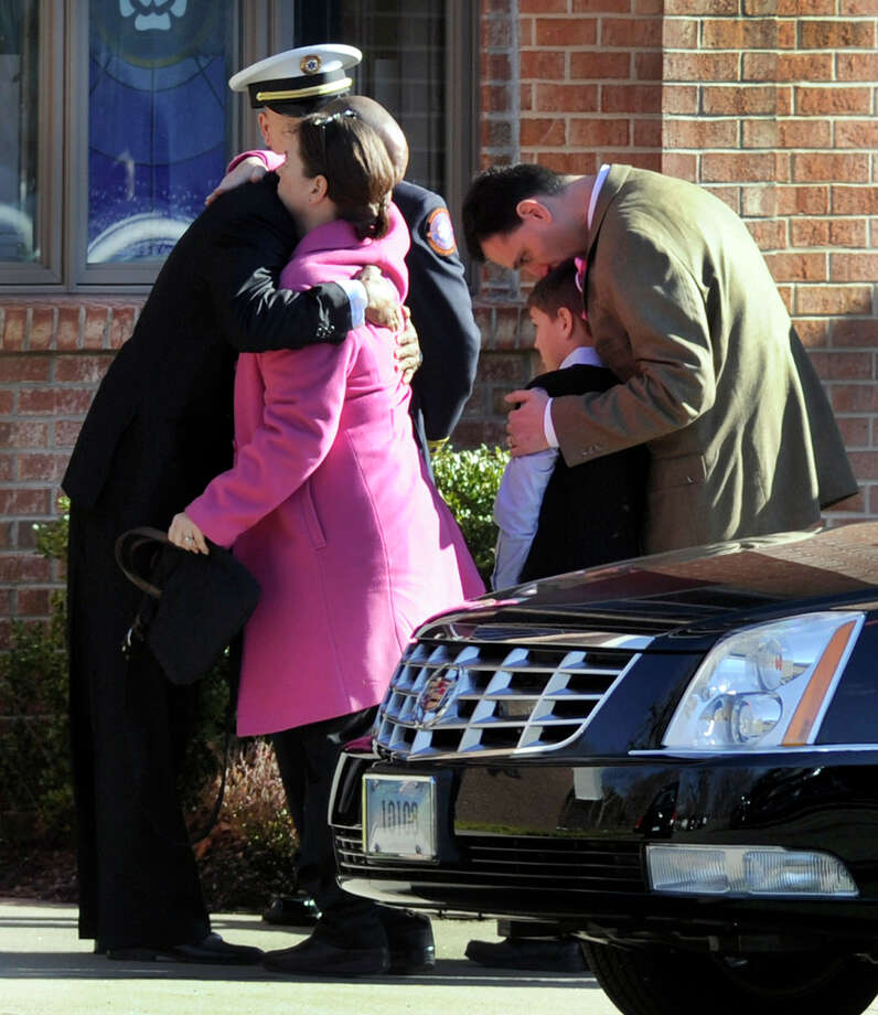 Mourners arrive for the funeral service for Charlotte Bacon at the Christ the King Lutheran Church in Newtown Wednesday, Dec. 19, 2012.
