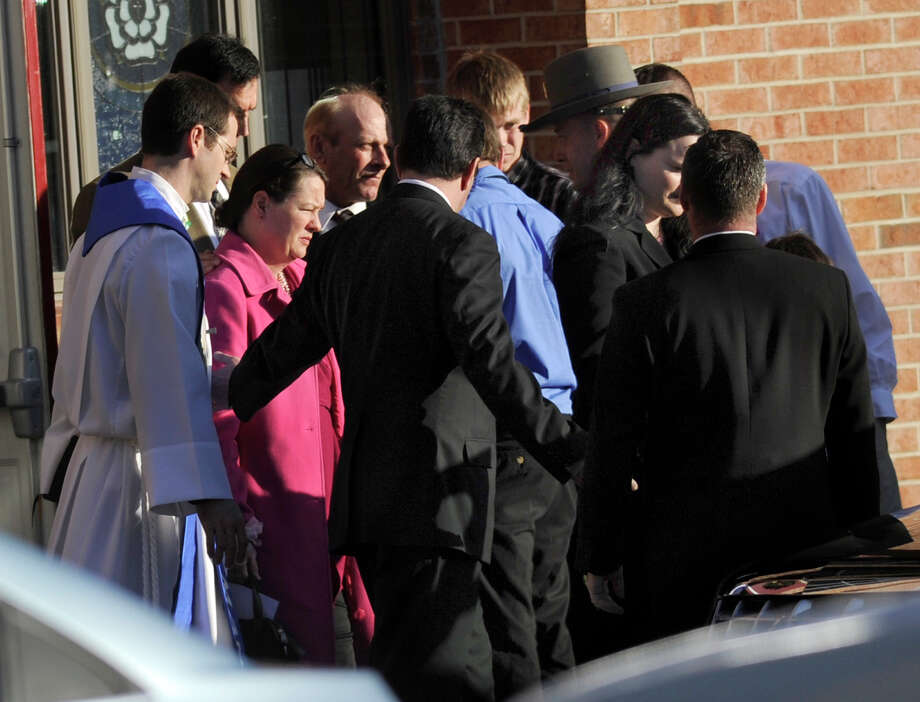 Mourners leave the funeral service for Charlotte Bacon at the Christ the King Lutheran Church in Newtown Wednesday, Dec. 19, 2012.  Charlotte was one of 26 children and educators killed friday at the Sandy Hook Elementary School by lone gunman Adam Lanza. Photo: Carol Kaliff / The News-Times