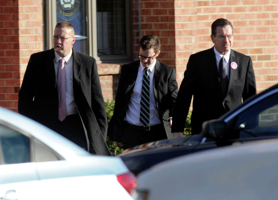 Gov. Dannel Malloy, far right, leaves the funeral service for Charlotte Bacon at Christ the King Lutheran Church in Newtown, Wednesday, Dec. 20, 2012.
