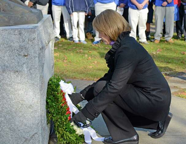 First Selectman Jaymie Stevenson placed a wreath on the firefighters memorial at Veterans Cemetery in Darien to honor the students and staff of Sandy Hook Elementary School who were killed on Dec. 14.  Darien, Conn, Dec. 15, 2012. Photo: Jeanna Petersen Shepard