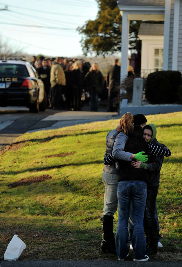 People embrace outside funeral of Sandy Hook principal Dawn Lafferty Hochsprung at the Munson Lovetere funeral home in Woodbury on Wednesday, Dec. 19, 2012. Photo: Jason Rearick / The News-Times