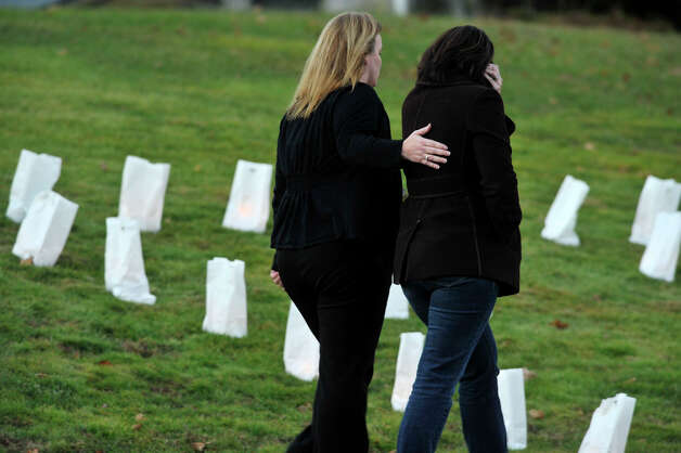 People leave the funeral of Sandy Hook principal Dawn Lafferty Hochsprung at the Munson Lovetere funeral home in Woodbury on Wednesday, Dec. 19, 2012. Photo: Jason Rearick / The News-Times