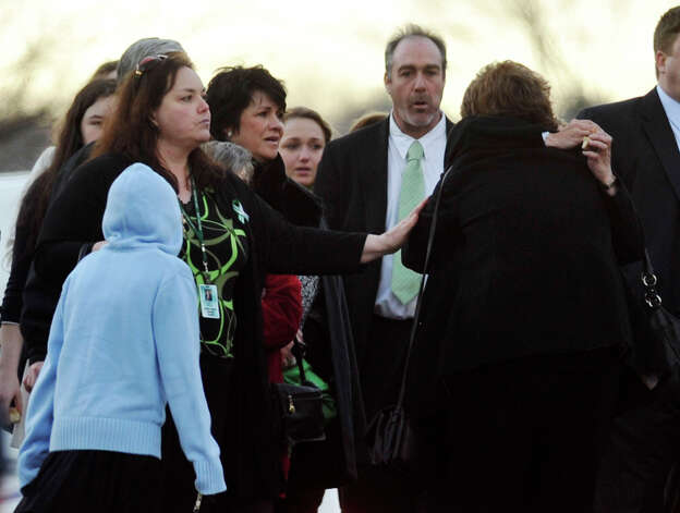 People arrive to the funeral of Sandy Hook principal Dawn Lafferty Hochsprung at the Munson Lovetere funeral home in Woodbury on Wednesday, Dec. 19, 2012. Photo: Jason Rearick / The News-Times