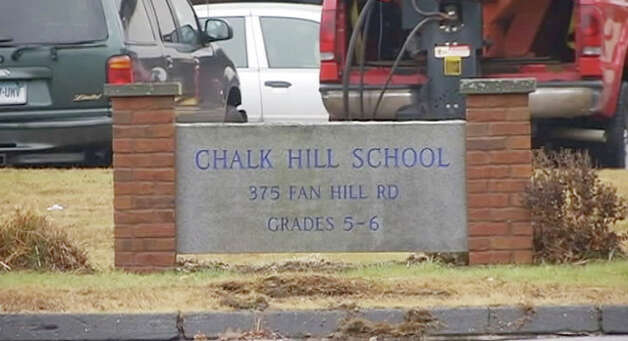 Workers setup Chalk Hill Middle School in Monroe, Conn. for use by students from Sandy Hook Elementary School from Newtown in the New Year. Photo: Contributed Photo / The News-Times Contributed