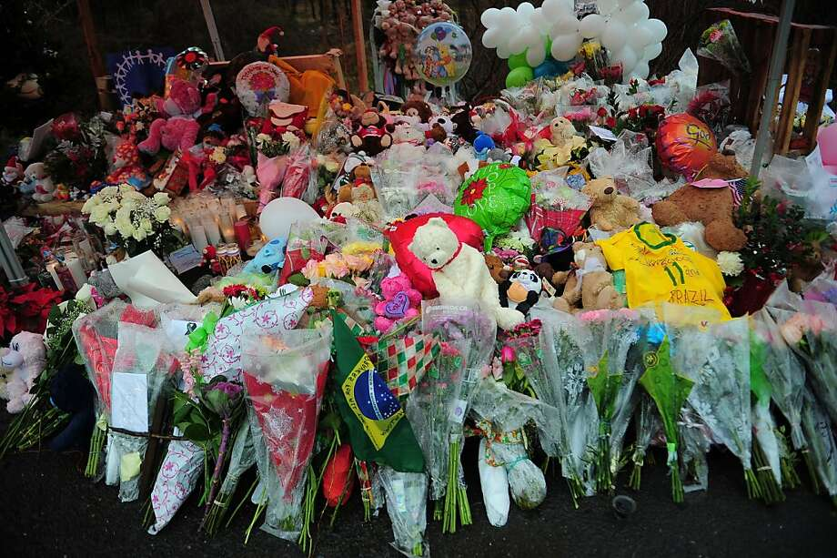 A growing shrine to the victims of the Sandy Hook Elementary School shooting in Newtown, Conn., is filled with flowers, stuffed animals and balloons. Photo: Emmanuel Dunand, AFP/Getty Images