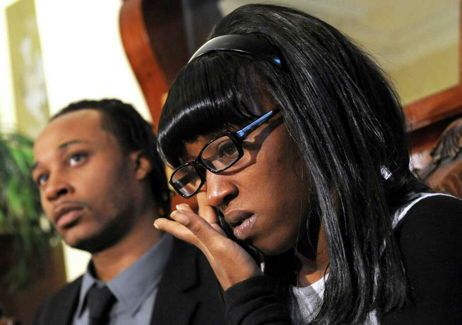 Amari Welburn's father, Derek Welburn, left, and her mother, Marasia VanNess speak during a press conference in Albany, NY Friday Nov. 2, 2012. (Michael P. Farrell/Times Union) Photo: Michael P. Farrell / 00019927A