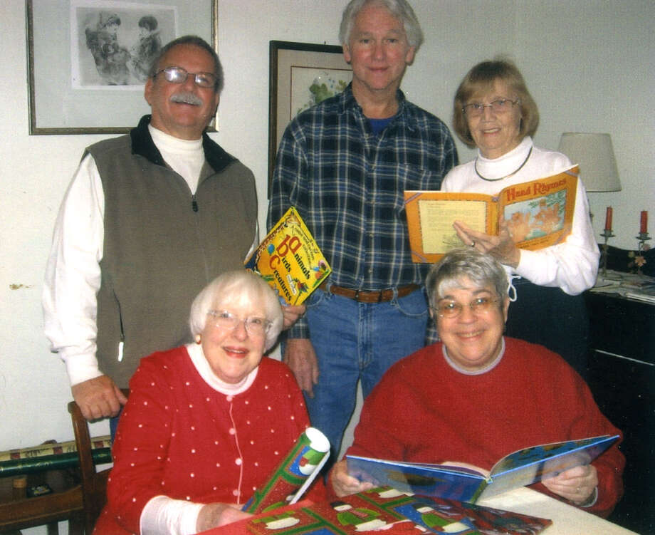 On Nov. 29, Helen Gaige Niki Mook, Marion Renning, Wes Neer and Paul LeBlanc gift-wrapped almost 200 nearly new or gently used books for distribution to needy children by charitable organizations in Saratoga Springs, notably the Saratoga County Economic Opportunity Council through its soup kitchen, the Women Infant and Children programs and the Franklin Community Center. The effort, known as the Marie Morrison Holiday Children?s Book Project, was started in 2002 by Morrison, a board member of the Friends of the Saratoga Springs Public Library and a principal founder of the library?s used-book shop, the Book Bag. (Wes Neer)