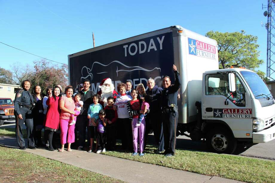 "Gallery Furniture and the Harris County Sheriff's Department joined together to surprise Patricia Mejia, a single mother of seven, with a houseful of new furniture on Thursday. A single mattress and a children's ""play"" table were the only furnishings the family had prior to the Christmas delivery. Despite the hardships the children maintain perfect attendance and are in the gifted and talented programs at Carrillo Elementary, Jackson Middle School and Milby High School. Photo: Gallery Furniture"