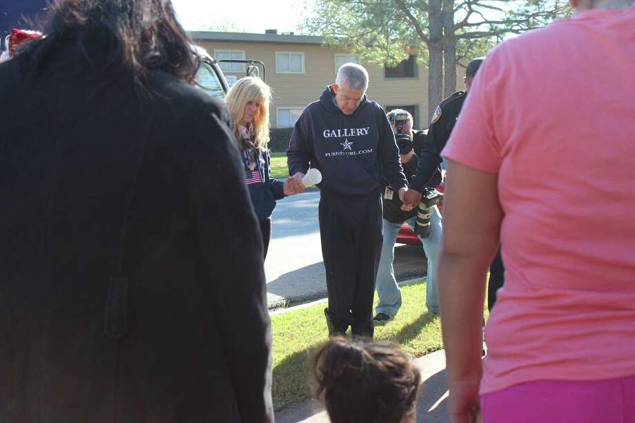 """Gallery Furniture and the Harris County Sheriff's Department joined together to surprise Patricia Mejia, a single mother of seven, with a houseful of new furniture on Thursday. A single mattress and a children's """"play"""" table were the only furnishings the family had prior to the Christmas delivery. Despite the hardships the children maintain perfect attendance and are in the gifted and talented programs at Carrillo Elementary, Jackson Middle School and Milby High School. Photo: Gallery Furniture"""
