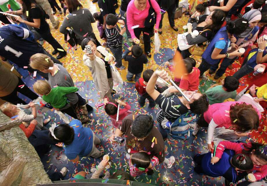 Kids at the Children's Museum kicked off 2011 with a Kid's Countdown at noon on Friday Dec. 31, 2010. The children made noisemakers and 2011 hats before counting down at noon with sparkling cider and flutter confetti. 800 people attended the event. HELEN L. MONTOYA/hmontoya@express-news.net Photo: HELEN L. MONTOYA, SAN ANTONIO EXPRESS-NEWS / hmontoya@express-news.net