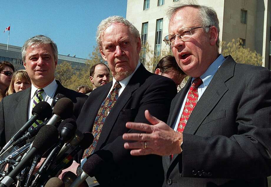 (FILES) Former Whitewater Independent Counsel Kenneth Starr (R) speaks to reporters as Robert Bork (C) and Mike Pettit, President of ProComp look on during a press conference in this February 26,, 2001 file photo outside of the US Federal Courthouse in Washington, DC.  Robert Bork, former federal judge and Supreme Court nominee, has died, his family confirmed to FoxNews.com on December 19, 2012. Family members said Bork, 85, died early Wednesday morning. He had a history of heart problems and chronic obstructive pulmonary disease, a lung condition.  AFP PHOTO/ Manny CENETAMANNY CENETA/AFP/Getty Images Photo: Manny Ceneta, AFP/Getty Images