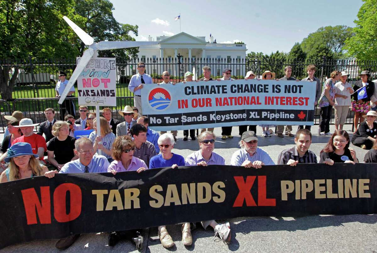 Environmental activists gather outside the White House last year to protest the Keystone XL pipeline project.