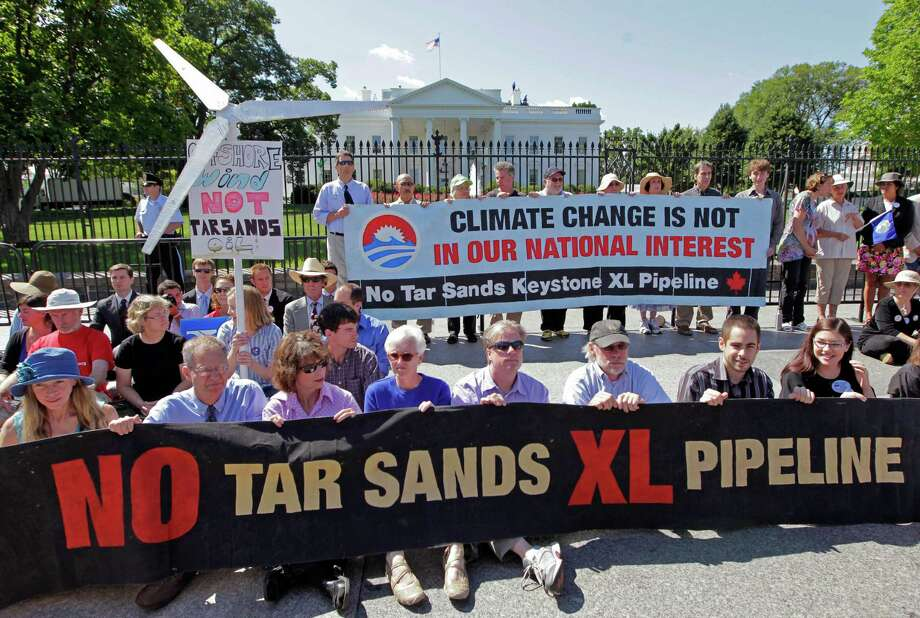 Environmental activists gather outside the White House last year to protest the Keystone XL pipeline project. Photo: J. Scott Applewhite, STF / AP