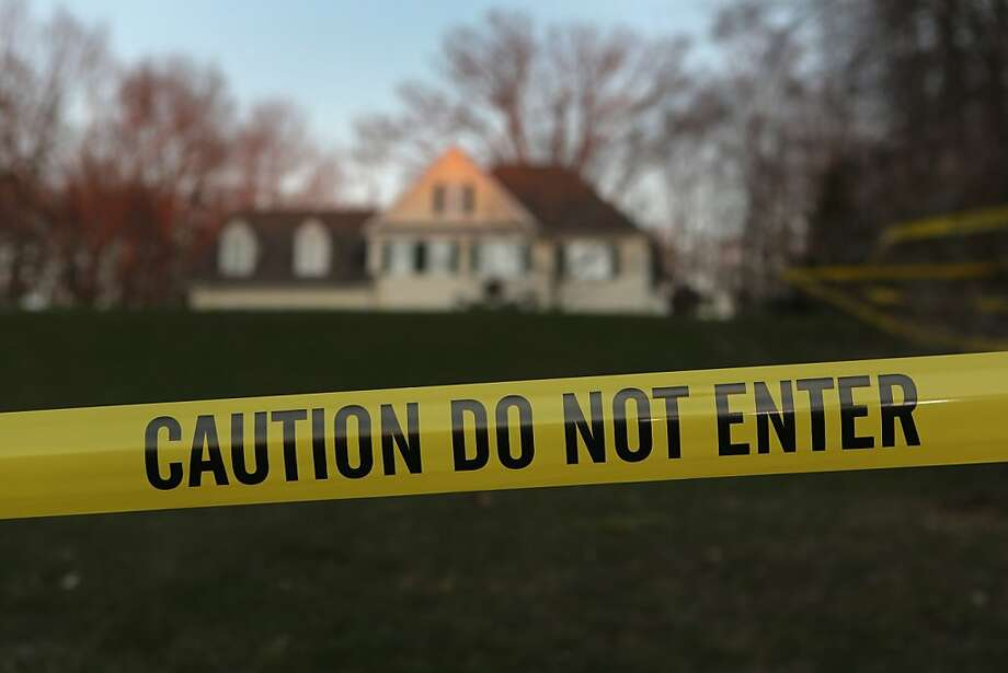 NEWTOWN, CT - DECEMBER 19:  Police tape stretches across the front yard of the Lanza residence on December 19, 2012 in Newtown, Connecticut. Adam Lanza reportedly shot his mother Nancy Lanza last Friday before he killed 26 others, including 20 children, at Sandy Hook Elementary School.  (Photo by John Moore/Getty Images) Photo: John Moore, Getty Images