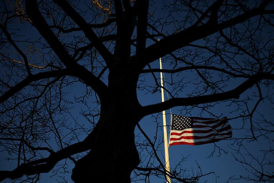 A U.S. flag flies at half-staff in honor of the Sandy Hook Elementary School shooting victims, Wednesday, Dec. 19, 2012, in Newtown, Conn. (AP Photo/David Goldman) Photo: David Goldman, Associated Press