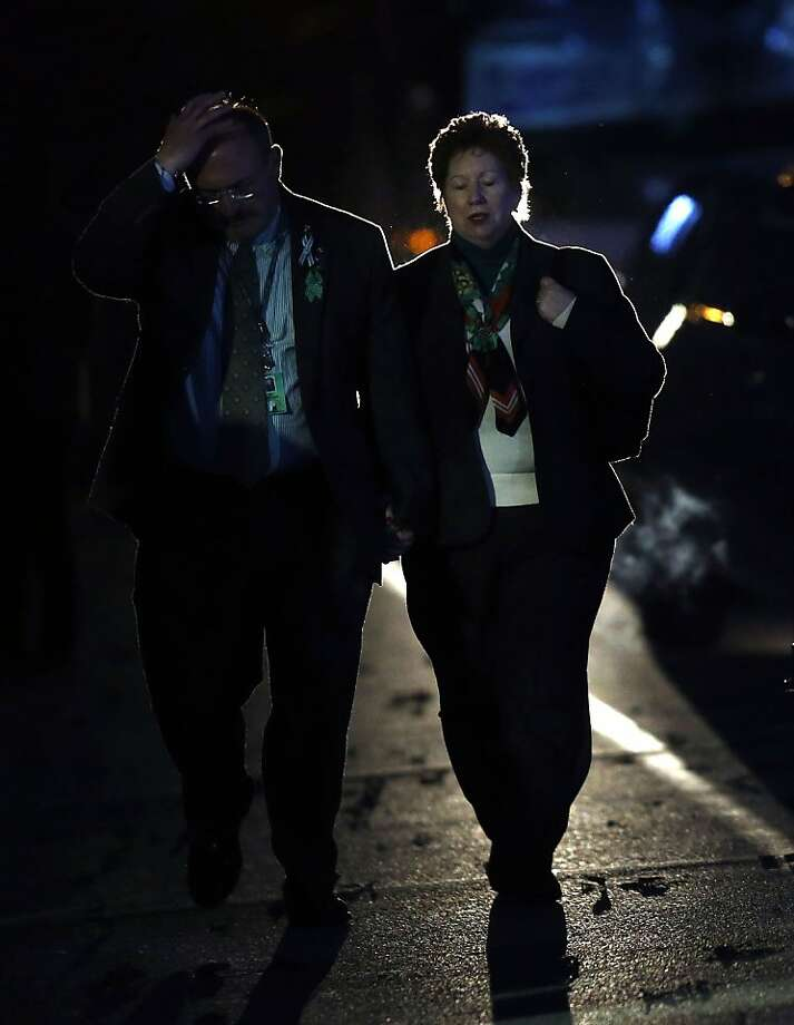 Mourners leave the calling hours of Sandy Hook Elementary principal Dawn Lafferty Hochsprung at Lordship Community Church, Wednesday, Dec. 19, 2012, in Woodbury, Conn.  Hochsprung was killed when a gunman forced his way into Sandy Hook Elementary School in Newtown on Dec. 14 and opened fire, killing 26 people, including 20 children. (AP Photo/Jason DeCrow) Photo: Jason DeCrow, Associated Press