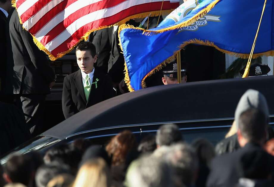 STRATFORD, CT - DECEMBER 19:  Mourners depart the funeral of slain teacher Victoria Soto, 27, at the Lordship Community Church on December 19, 2012 in Stratford, Connecticut. The first grade teacher died while reportedly trying to protect her students during last Friday's shooting massacre at Sandy Hook Elementary School in Newtown.  (Photo by John Moore/Getty Images) Photo: John Moore, Getty Images
