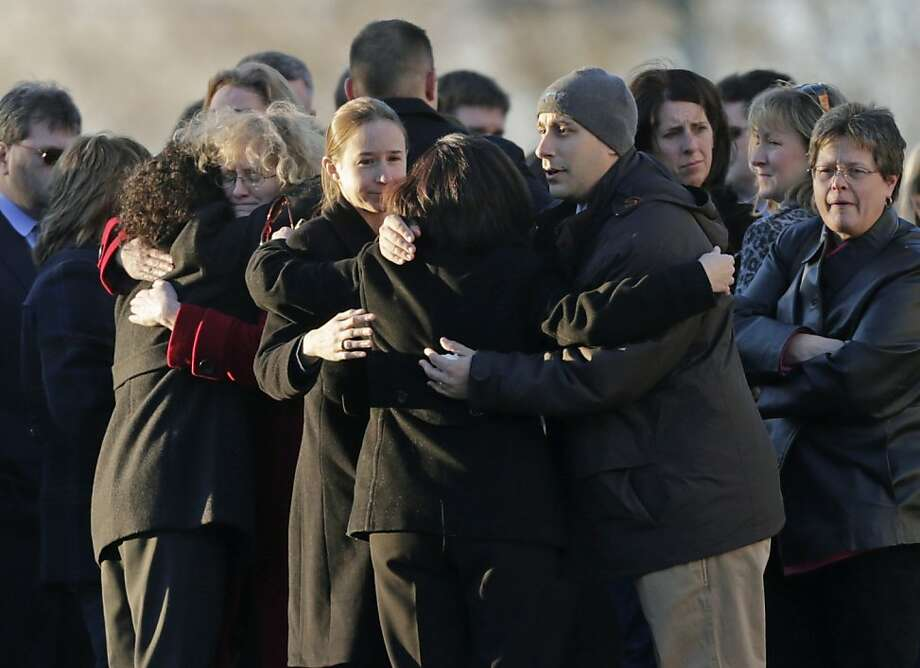 Mourners embrace at the wake of Sandy Hook Elementary School principal Dawn Lafferty Hochsprung in Woodbury, Conn., Wednesday, Dec. 19, 2012. Hochsprung, was killed when Adam Lanza walked into Sandy Hook Elementary School in Newtown, Conn., Dec. 14, and opened fire, killing 26 people, including 20 children, before killing himself.  (AP Photo/Charles Krupa) Photo: Charles Krupa, Associated Press