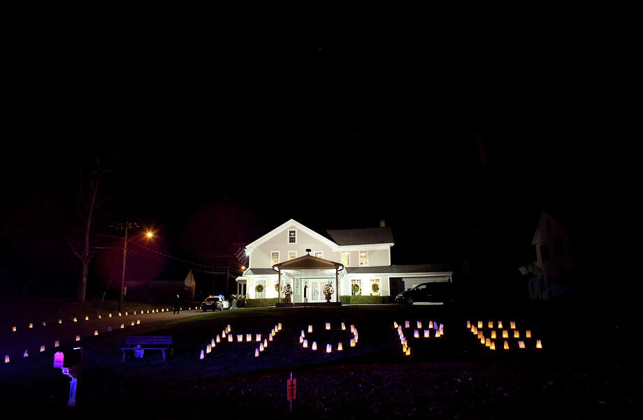 "WOODBURY, CT - DECEMBER 19:  Bagged candles spelling the word ""hope"" are laid on the lawn of the wake for school principal Dawn Hochsprung, December 19, 2012 in Woodbury, Connecticut. Six victims of the Newtown school shooting are being honored at funerals and visitations across the state today for the victims of Sandy Hook Elementary School. Photo: Allison Joyce, Getty Images / 2012 Getty Images"