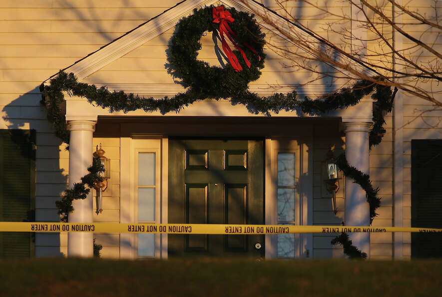NEWTOWN, CT - DECEMBER 19:  Police tape stretches across the front yard of the Lanza residence on De