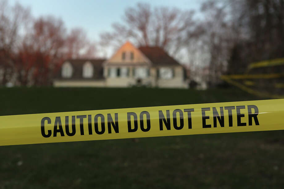 NEWTOWN, CT - DECEMBER 19:  Police tape stretches across the front yard of the Lanza residence on December 19, 2012 in Newtown, Connecticut. Adam Lanza reportedly shot his mother Nancy Lanza last Friday before he killed 26 others, including 20 children, at Sandy Hook Elementary School. Photo: John Moore, Getty Images / 2012 Getty Images