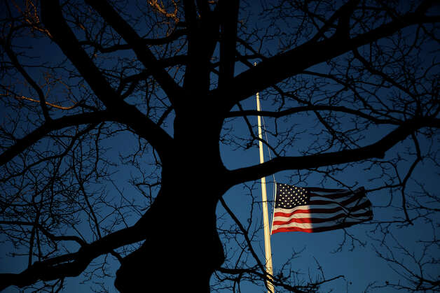 A U.S. flag flies at half-staff in honor of the Sandy Hook Elementary School shooting victims, Wednesday, Dec. 19, 2012, in Newtown, Conn. Photo: AP