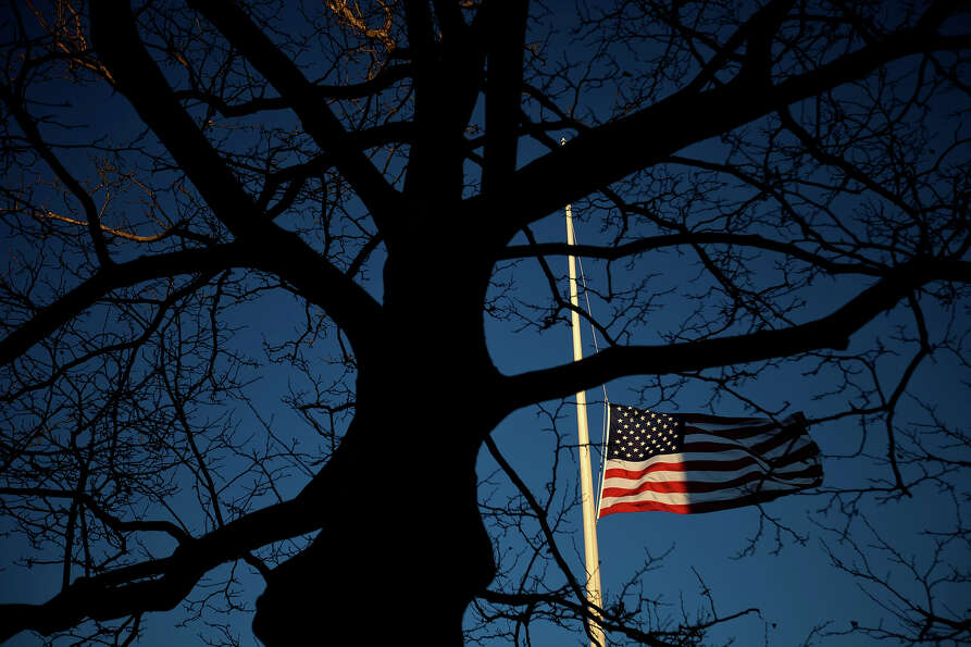 A U.S. flag flies at half-staff in honor of the Sandy Hook Elementary School shooting victims, Wedne